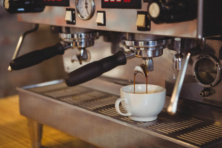 Machine making a cup of coffee in a cafe